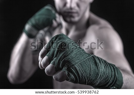 Close-up of hand of boxer ready for a fight. Concept. Strong arms and clenched fists