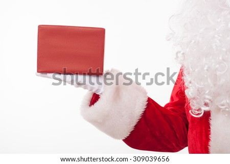 Close up of hand of Santa Claus. He is holding a red box of gift on his palm. Isolated - stock photo