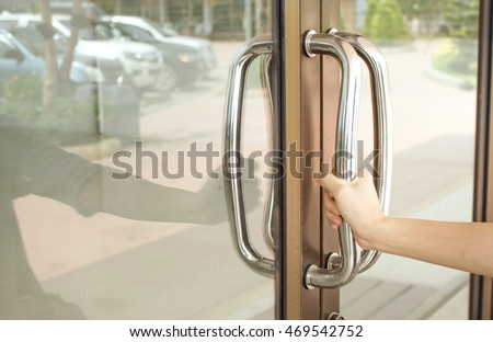 Closeup hand open aluminum glass door stock photo royalty free close up of hand open aluminum glass door holding handle planetlyrics Image collections