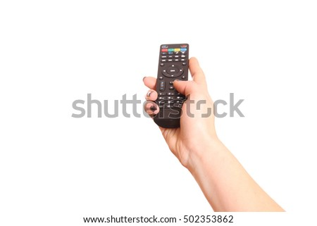 Close up of hand operating a TV remote control.