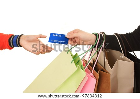Close-up of hand passing over credit card to shop assistant after shopping MasterCard - stock photo
