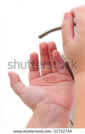 Close up of hand sanitizer being poured into child hands. Isolated on white. - stock photo