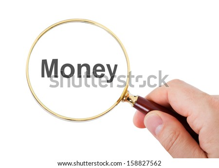 Close-up Of Hand Showing Money Word Through Magnifying Glass Over White Background