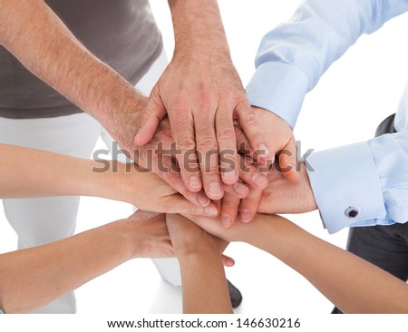 Close-up Of Hand Stacked Over Each Other On White Background