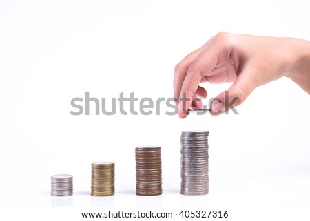 Close up of hand stacking coins on white background, Money growing concept, Save money with stack money coin for growing your business. - stock photo
