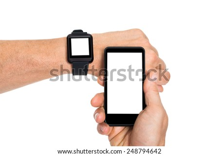 Close-up Of Hand Wearing Blank Screen Smartwatch And Holding Cellphone Over White Background - stock photo
