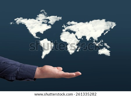Close up of hand with cloud world map - stock photo