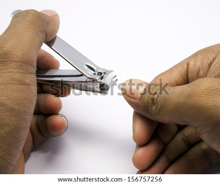 close up of hand with nail clipper - stock photo