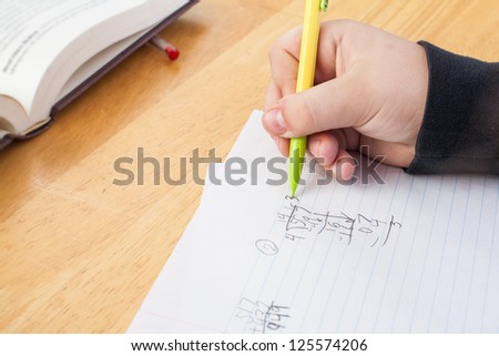 close up of hand with pencil doing math - stock photo