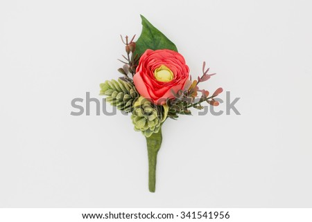 Close up of handmade wedding floral accessory. Decoration for hands or buttonhole. Isolated over white background - stock photo
