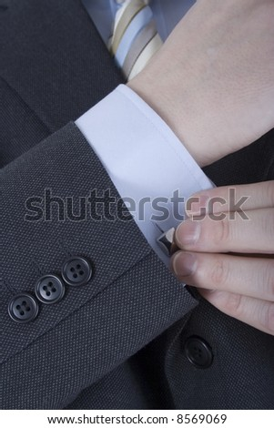 Close up of Hands and Cuffs - stock photo