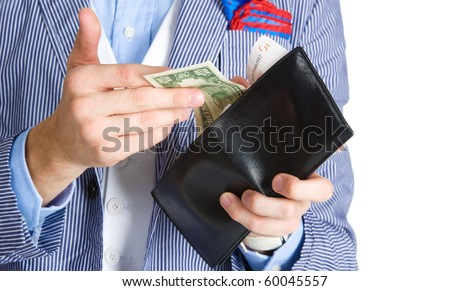 Close-up of hands holding the bills and purse - stock photo