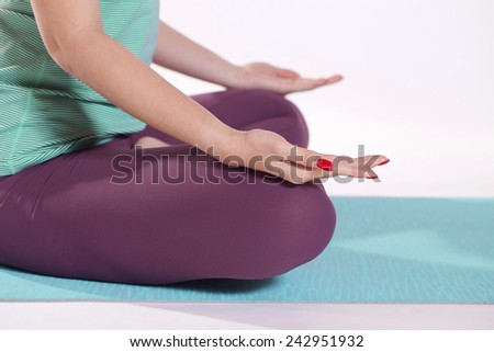 Close up of hands in yoga pose - stock photo