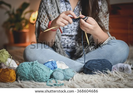 Close-up of hands knitting - stock photo