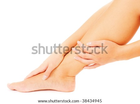 Close up of hands massaging a leg, from a complete series of photos. - stock photo