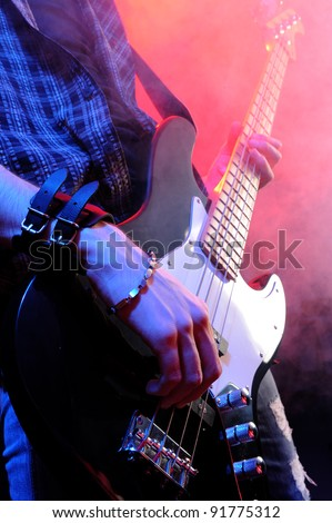 close up of hands playing an bass - stock photo