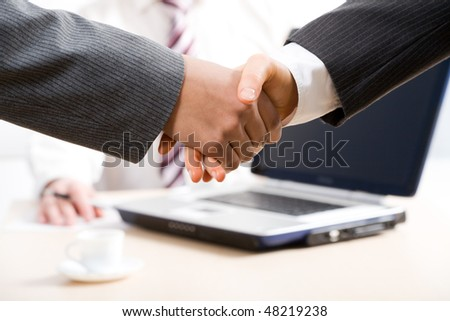 Close-up of hands shake between two successful business people