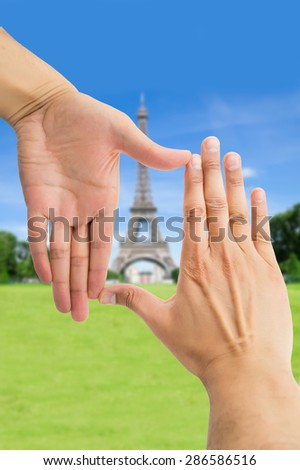 close up of hands symbol that means frame over tower eifel in Paris  - stock photo