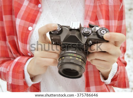 Close up of hands woman with old camera.Full-format camera.Photographer.Woman holding old vintage camera - stock photo