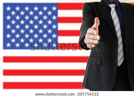 close up of handshake with USA flag - stock photo