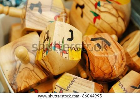 close up of hanukkah dreidels on market stand - stock photo
