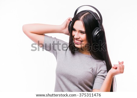 Close-up of happy brunet caucasian  girl listen dancing to music with headphones on a white background - stock photo