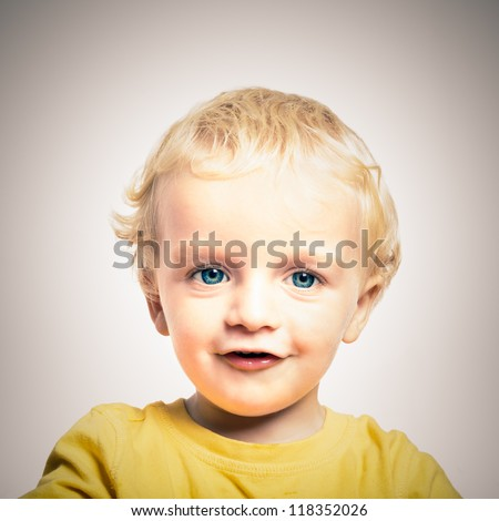Close up of happy cute adorable child boy. - stock photo