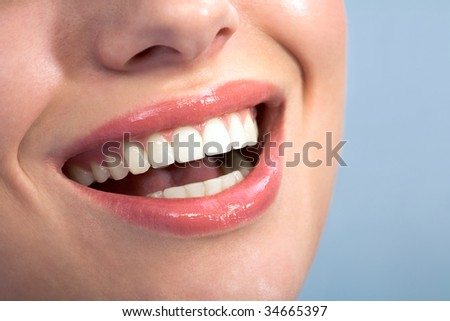 Close-up of happy female healthy teeth shown in smile
