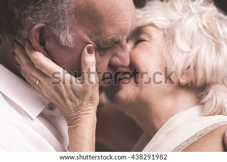Close up of happy senior married couple kissing