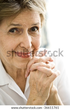 Close up of happy senior woman - stock photo