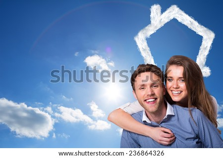 Close up of happy young couple against cloudy sky with sunshine - stock photo