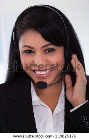 Close-up Of Happy Young Female Customer Representative - stock photo