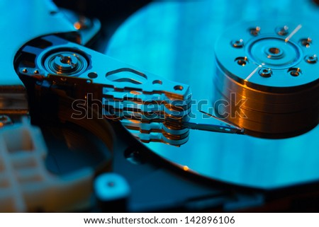 close up of hard disk with abstract reflection - stock photo