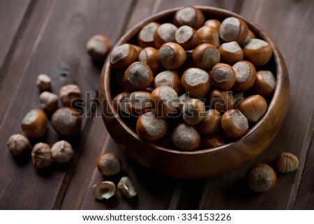 Close-up of hazelnuts in a wooden bowl, selective focus