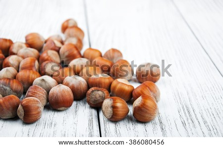 close-up of hazelnuts on a old wooden table - stock photo