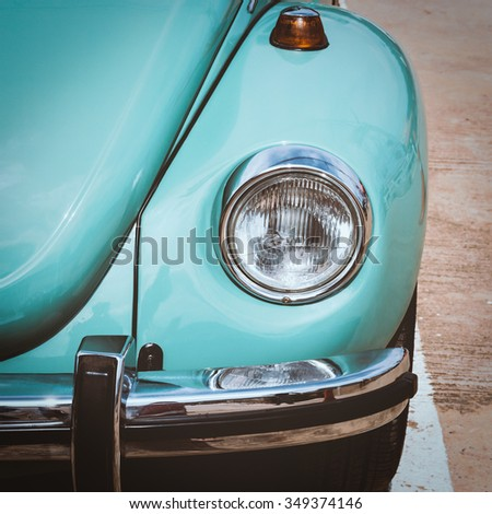 Close-up of headlight, vintage color tone picture - stock photo