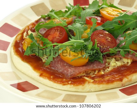 Close up of healthy pizza with rucola - stock photo