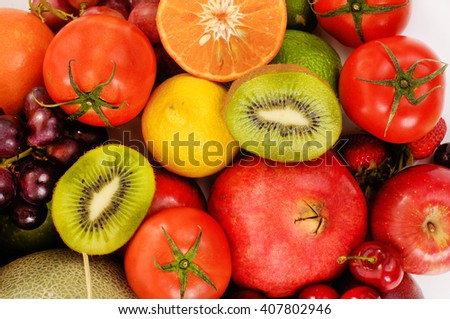 Close up of heap of fruit, isolated. Concept of healthy eating and dieting lifestyle