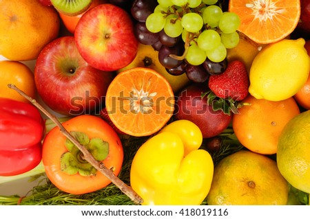 Close up of heap of fruit, isolated. Concept of healthy eating and dieting lifestyle - stock photo