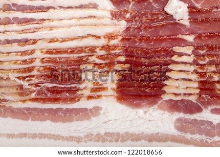 Close-up of heap of raw bacon. - stock photo