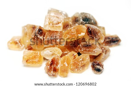 Close up of heap of sweet sugar candies over a white background