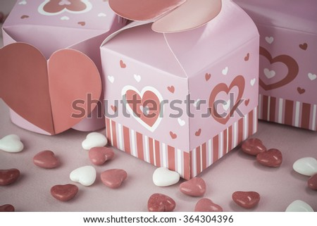 Close up of heart shaped candies in valentines day boxes.