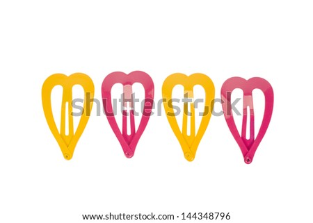 Close-up of heart shaped hair clips