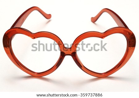 Close up of Heart shaped plastic glass for valentine's day - stock photo