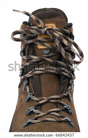 Close up of hiking boots shoelace