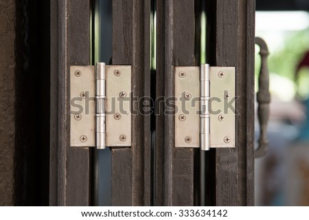 Close up of hing on the old wooden door - stock photo