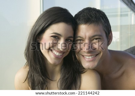 Close up of Hispanic couple smiling - stock photo