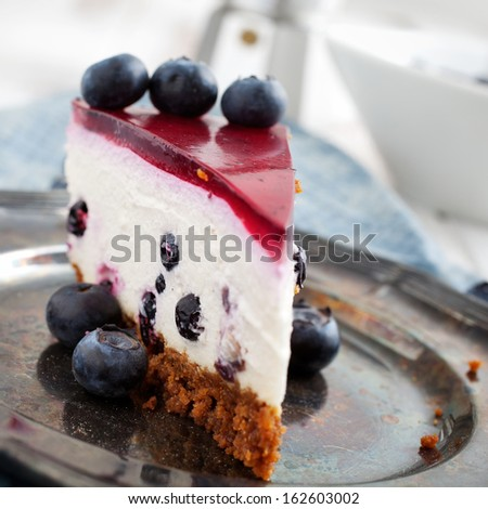 Close up of homemade blueberry cheesecake, selective focus - stock photo