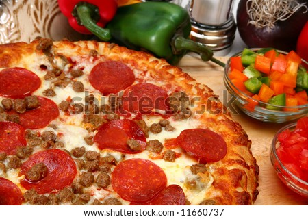 close up of homemade sausage and peperoni pizza - stock photo