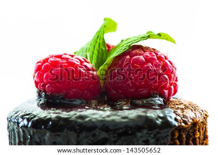 Close up of hot melting chocolate cake dessert with raspberry - stock photo